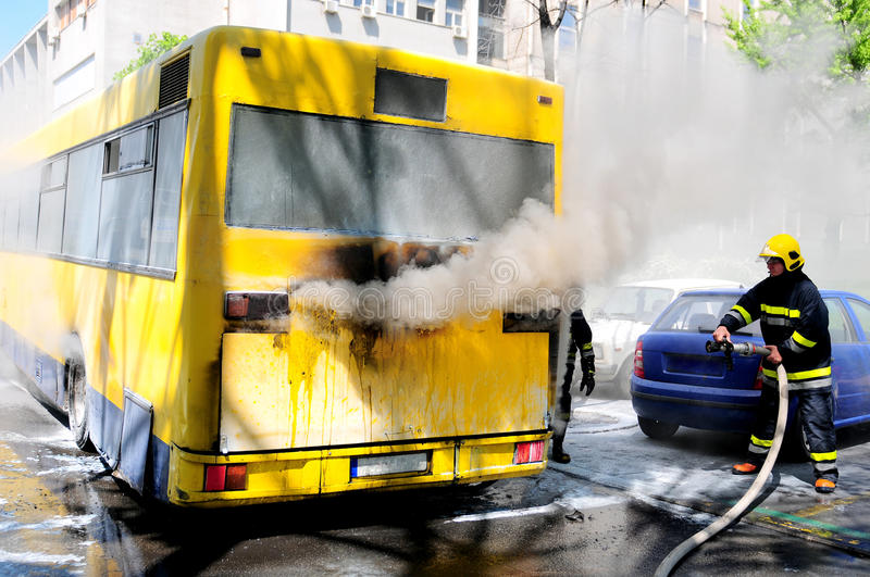 Bus on fire on the street in the middle of the day. SERBIA, BELGRADE - APRIL 27, 2012: Bus on fire on the street in the middle of the day. More than have of the stock image