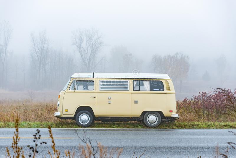 Bus in the fog stock photo