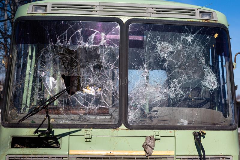 Bus glasses are heavily broken after car crashes on the road. The windows crashed when colliding at high speed stock photo