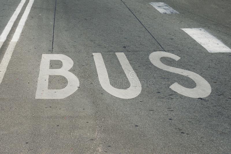 Bus, the inscription on the road. Defines the traffic on the road. Transport. Signs stock images