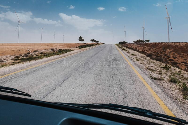 Bus journey in Jordan. Bus journey and travelling in Jordan desert road. Red stones. Tourism in a public transport. People transportation. Beautiful trip trough royalty free stock photos