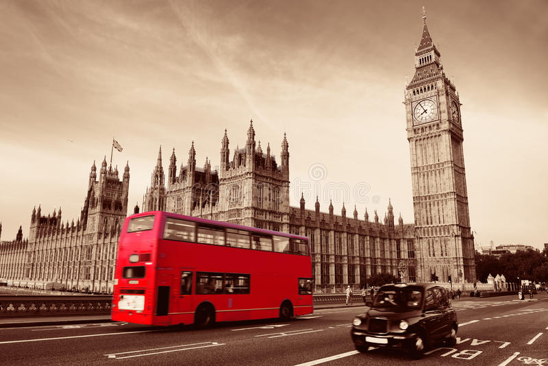 Bus in London. Double-deck red bus on Westminster Bridge with Big Ben in London stock image