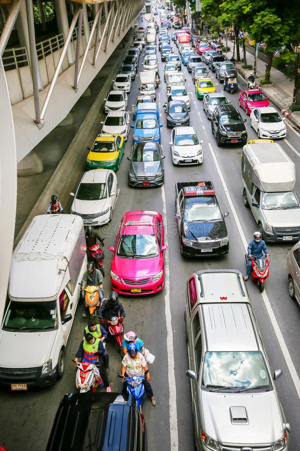 bus and motorcycles try to move in a traffic jam in the business district of Bangkok. The Thailand capital city is famous for its stock images
