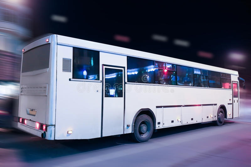 Bus moving on the night city royalty free stock photos