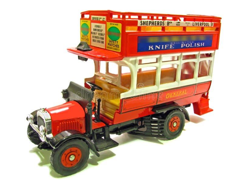 Bus rouge à couvercle serti général de cru image stock