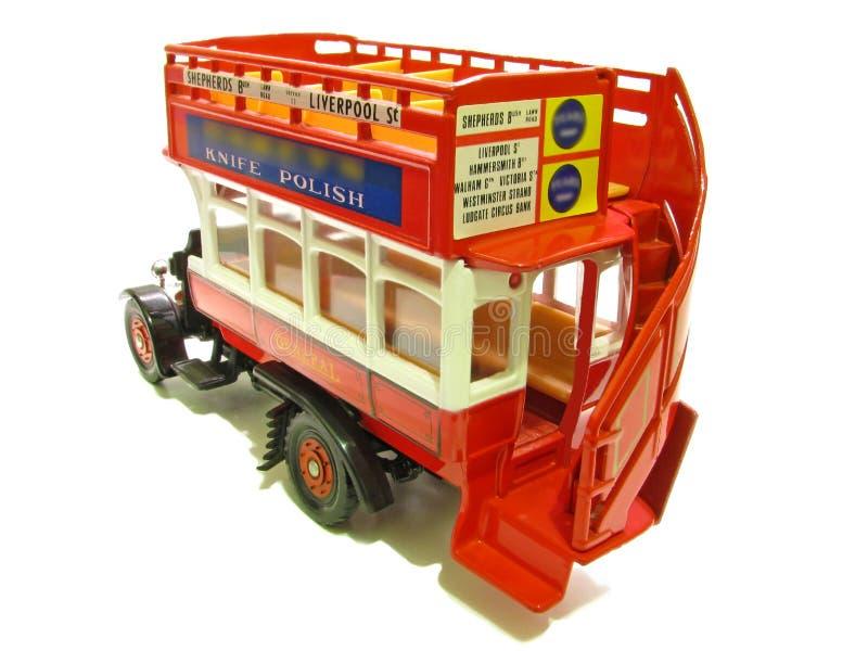 Bus rouge à couvercle serti général de cru images stock