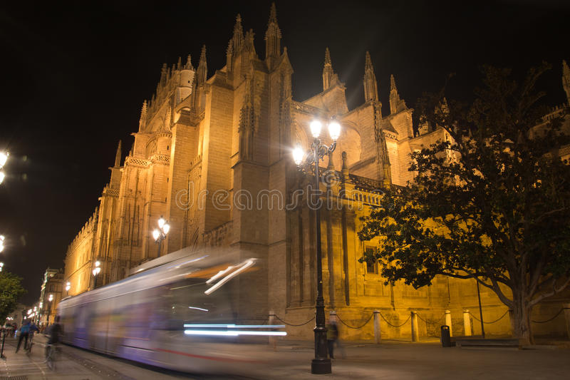 Lights in the night at Christmas in the Avenida de la Constitucion in the center of Seville, Spain,. The beautiful view of the Seville in the night with the bus stock photography