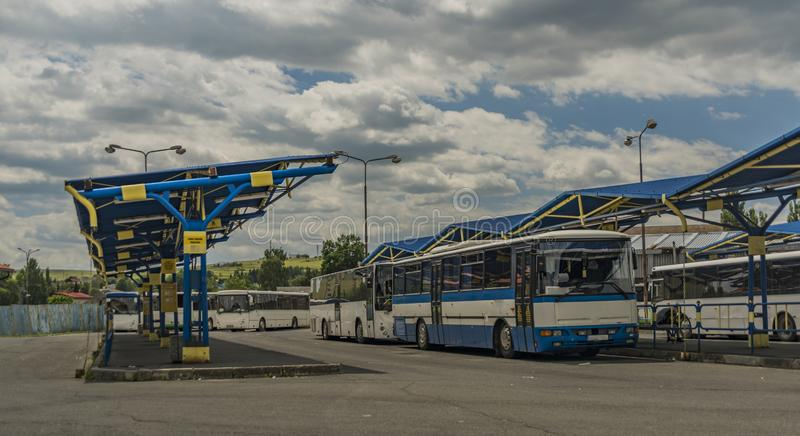 Bus station with blue coach and old platform in Kezmarok town royalty free stock image
