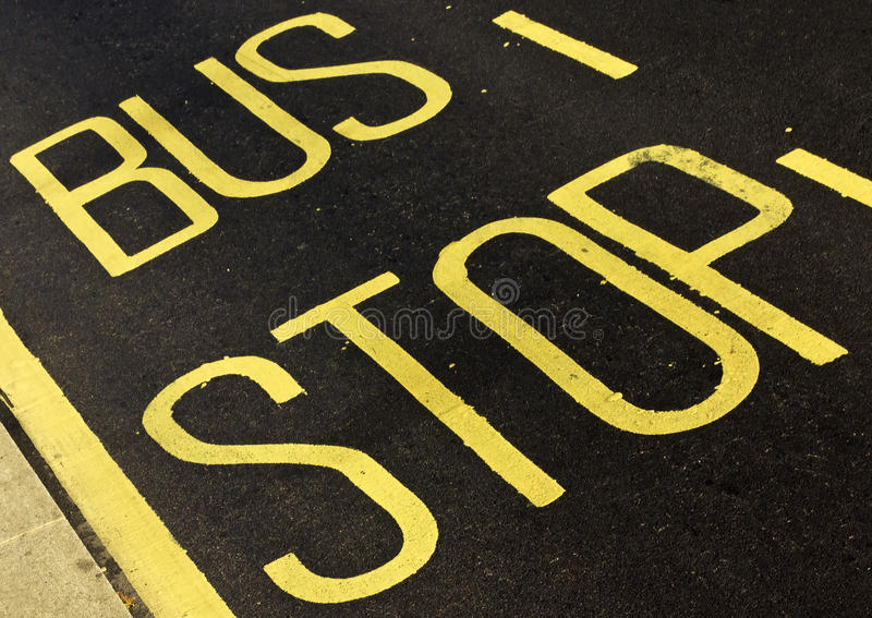 Bus Stop. Bus top sing on the road in London royalty free stock photo