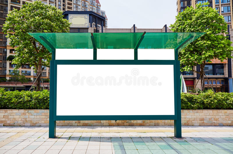 bus stop blank billboard stock photo