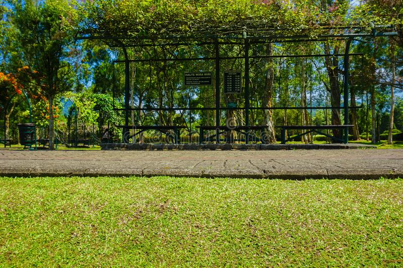 A bus stop or called halte with clean green grass on daylight summer stock images