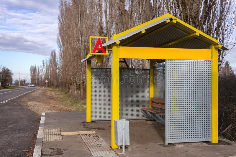 Bus stop in countryside in southern Russia. Sunny autumn day. There is place for advertising royalty free stock photo