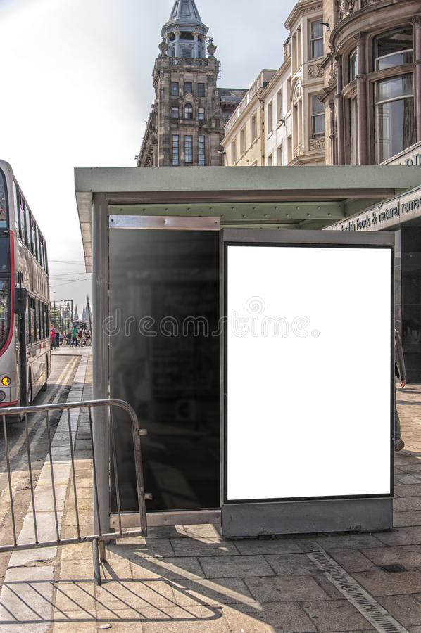 Bus Stop Edinburgh. An image of a bus stop with a blank bilboard for your advertising situated in the Scottish city of Edinburgh stock image