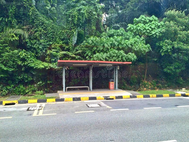Bus stop. Empty bus stop along a road in Peninsular Malaysia stock image
