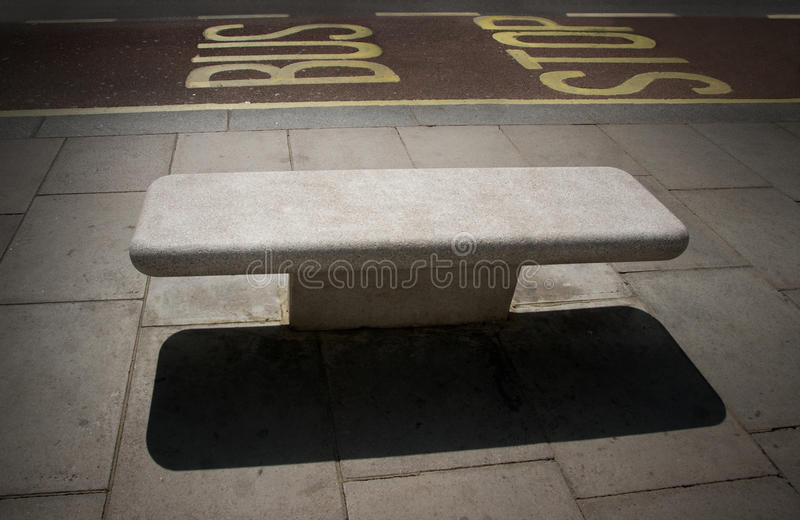 Bus stop with empty bench royalty free stock photos