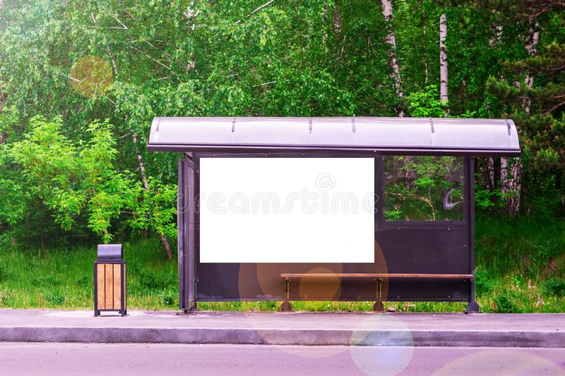 Bus stop near the road in the forest. Green background. copy space for text stock photos