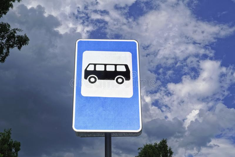 Bus stop road sign on background of blue sky. stock photo