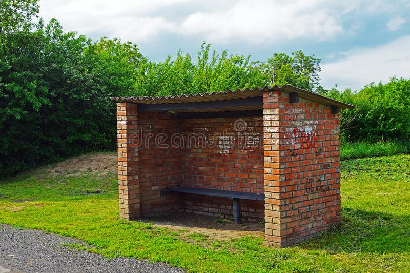Bus stop on a rural road. Bus stop with bricks on a rural road royalty free stock images