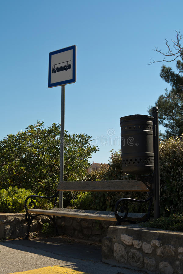 Bus stop sign and blue sky stock photo