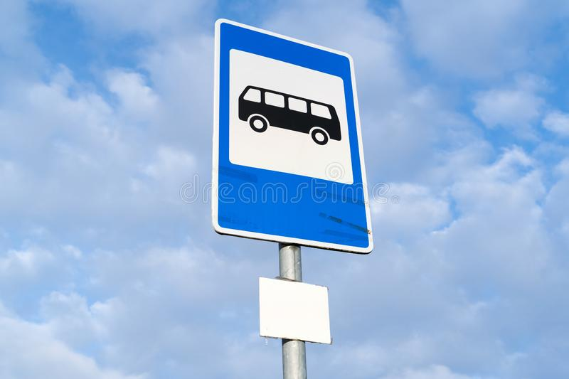 Bus stop sign. Blue and white bus stop sign in Europe with sky background royalty free stock photos
