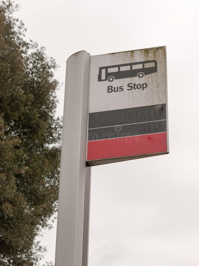 A bus stop sign with a bus icon white and black and red stock image