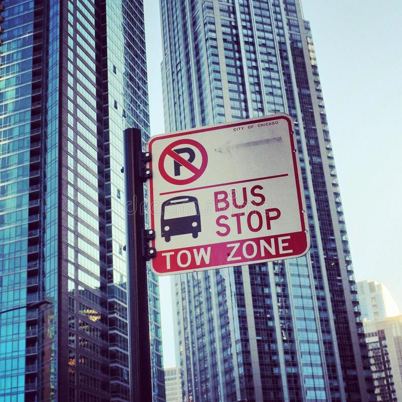 Bus stop sign. A bus stop sign with chicago building royalty free stock images