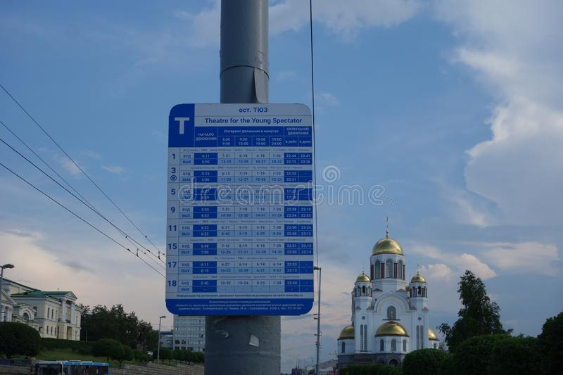Bus stop sign. EKATERINBURG, RUSSIA - CIRCA JUNE 2018: Bus stop sign with timetable stock image