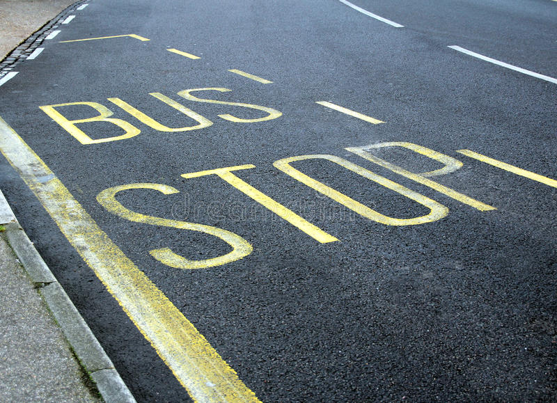 Bus stop sign lane stock image