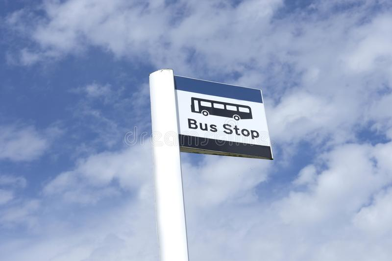 Bus stop sign sky background blue white clouds view below information public transport school old age pensioner travel free coach stock images