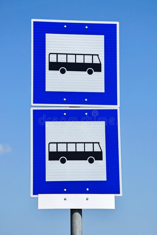 Bus stop traffic signs. In the city stock image