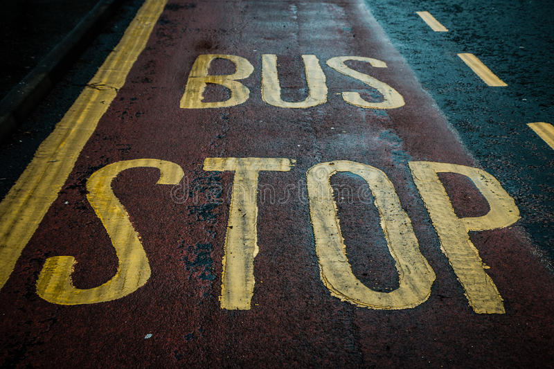 Bus Stop. Written on the road stock image
