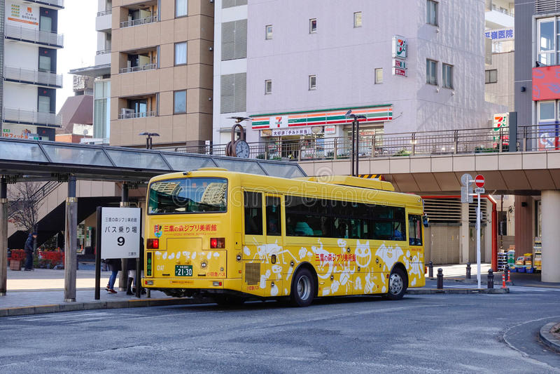 Bus stopping at station in Tokyo, Japan stock photos