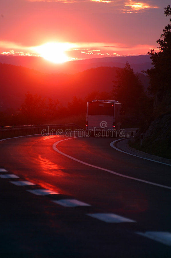 Bus in sunset royalty free stock photos
