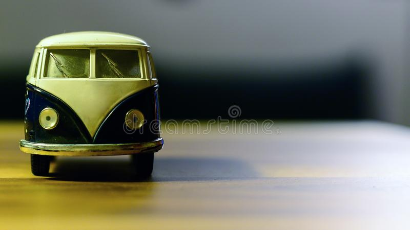 Bus toy on wooden background oriented on the side type cleavage available. Bus toy on wooden background oriented on the side type cleavage royalty free stock photos