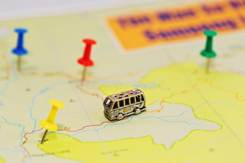 Bus travel map concept. Travel by bus concept with geographical roadmap - close-up capture with different pushpins and tiny bus figurine. Macro capture with stock photos