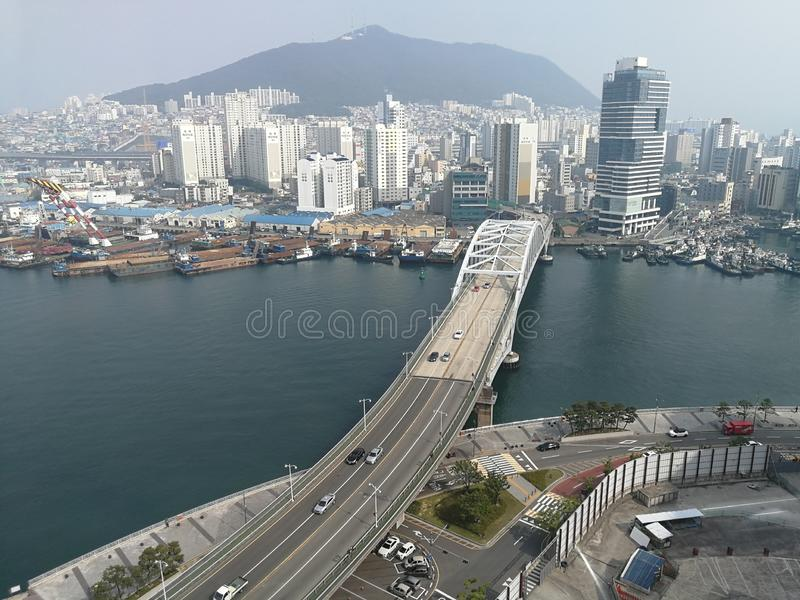 Busan City View. Busan, a large port city in South Korea, is known for its beaches, mountains and temples. Busy Haeundae Beach features the Sea Life Aquarium royalty free stock photography