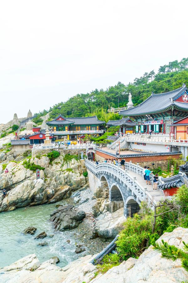 BUSAN, SOUTH KOREA-July 11, 2017: Tourist visits Haedong Yonggung. Temple is a Buddhist temple and large one and Temple sits upon a cliff overlooking the East stock photography
