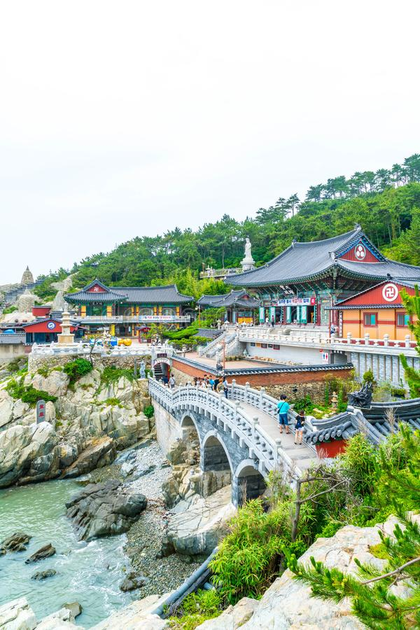 BUSAN,SOUTH KOREA-July 11,2017: Tourist visits Haedong Yonggung. Temple is a Buddhist temple and large one and Temple sits upon a cliff overlooking the East Sea stock image