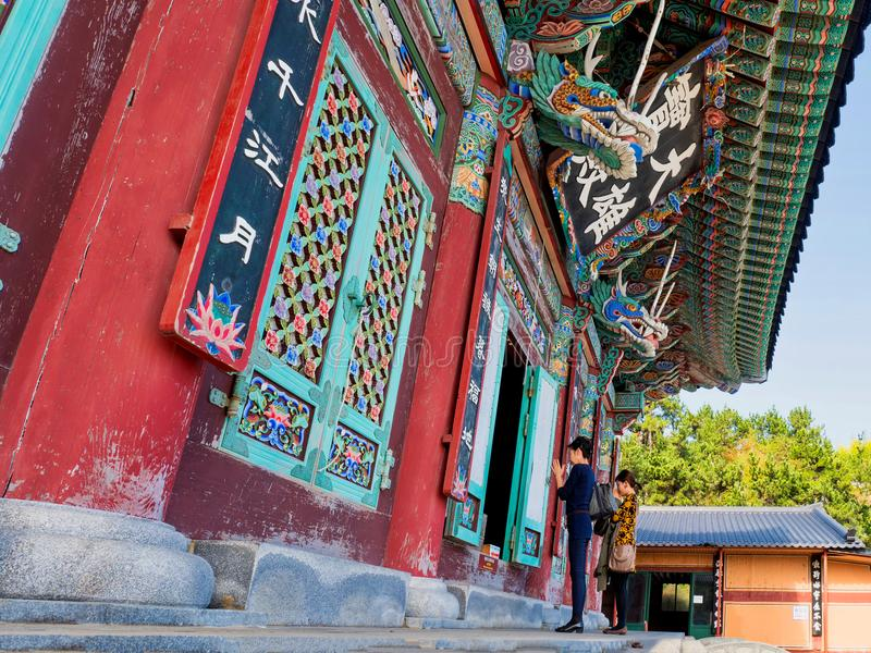 Haedong yonggungsa buddhist temple. Busan, south korea, 8th november 2017, buddhist worshippers at the beautiful haedong yonggungsa temple stock image