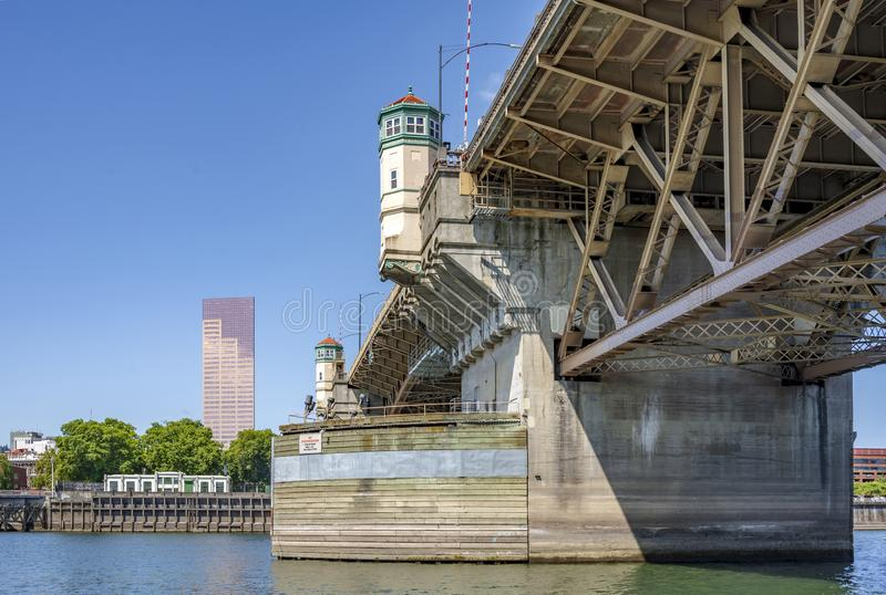 Buscle Burnside Bridge across Willamette River on the background of Portland Down Town. Wide transportation Burnside drawbridge over the Willamette River in down royalty free stock images