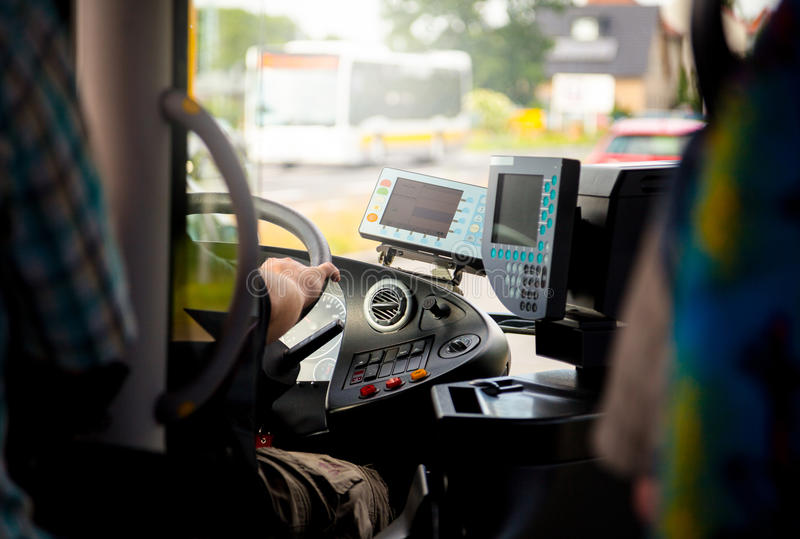 Busdriver in a cockpit. Onn the road royalty free stock photography