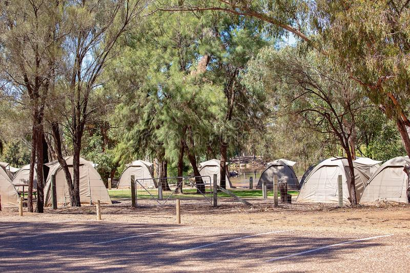 A Bush Camp For Tourists. Tent campsite in bushland for tourists at a wildlife park zoo in Australia stock photos