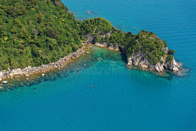 Bush clad hills reach down to the sea in New Zealand`s Abel Tasman National Park stock photo
