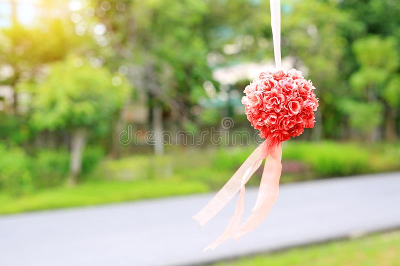 Bush of decoration artificial rose hanging in the nature park. Wedding decorative in the green garden outdoor stock photography