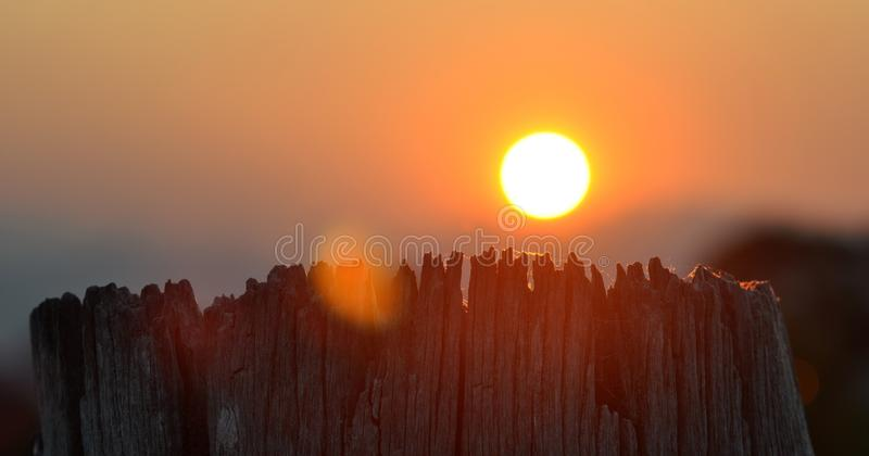 Bushfire Sunset Over Weathered Fence Post royalty free stock photos