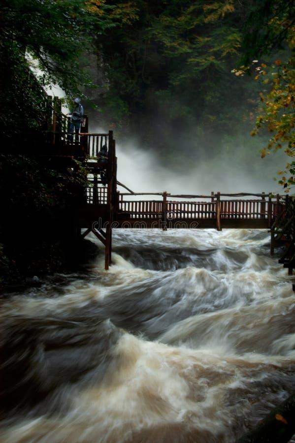 Bushkill Falls at flood stage. Bushkill Falls at flood stage during late autumn storms in Pocono Mountains, Bushkill, Pennsylvania stock image