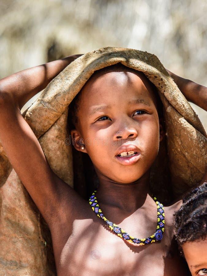 Bushman people in Namibia. EAST OF WINDHOEK, NAMIBIA - JAN 3, 2016: Unidentified bushman boy. Bushman people are members of various indigenous hunter-gatherer stock photo
