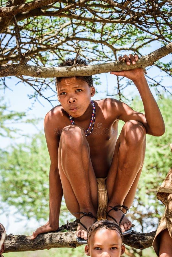 Bushman people in Namibia. EAST OF WINDHOEK, NAMIBIA - JAN 3, 2016: Unidentified bushman boy. Bushman people are members of various indigenous hunter-gatherer royalty free stock images