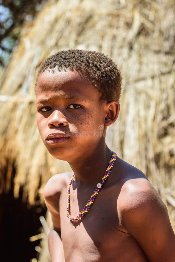 Bushman people in Namibia. EAST OF WINDHOEK, NAMIBIA - JAN 3, 2016: Unidentified bushman little boy. Bushman people are members of various indigenous hunter stock photo