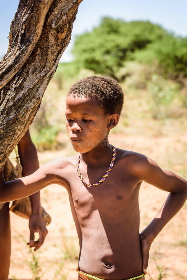 Bushman people in Namibia. EAST OF WINDHOEK, NAMIBIA - JAN 3, 2016: Unidentified bushman little boy. Bushman people are members of various indigenous hunter royalty free stock photos
